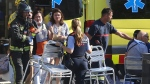 Injured people are treated in Barcelona, Spain, Thursday, Aug. 17, 2017 after a white van jumped the sidewalk in the historic Las Ramblas district, crashing into a summer crowd of residents and tourists and injuring several people, police said. (AP / Oriol Duran)