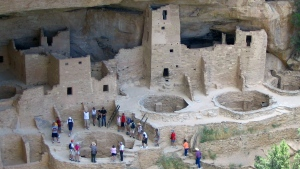 In this Aug. 27, 2005 file photo, visitors tour Cliff Palace, an ancient cliff dwelling in Mesa Verde National Park, Colo. (Beth J. Harpaz / The Associated Press)