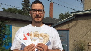 AIDS Saskatoon executive director Jason Mercredi shows off pamphlets, written in Cree, Dene and English, aimed to educate on HIV and hepatitis C. (Mark Villani/CTV Saskatoon)