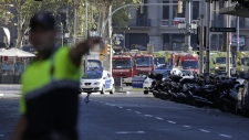 Police officer gestures in Barcelona, Spain