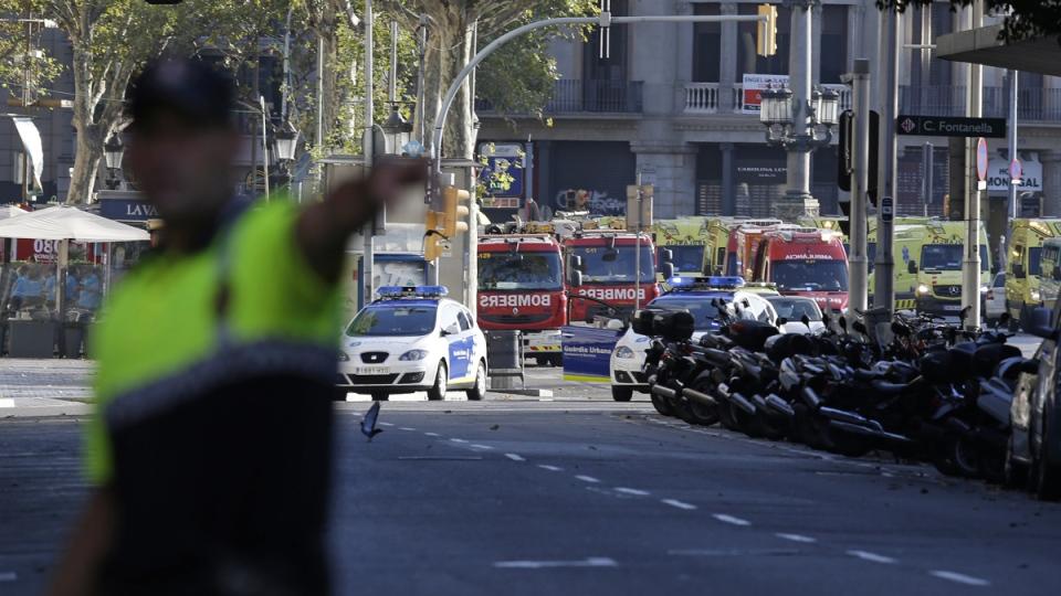 A police officer gestures as he blocks a street in Barcelona, Spain, Thursday, Aug. 17, 2017. (Manu Fernandez / AP)