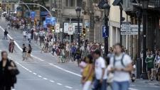 People walk down a main street in Barcelona, Spain, on Aug. 17, 2017. (Manu Fernandez / AP)