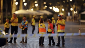 Emergency workers stand on a blocked street in Barcelona, Spain, on Aug. 17, 2017. (Manu Fernandez / AP)