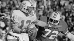 In this Nov. 14, 1983 file photo, Miami Dolphins quarterback Dan Marino (13) scrambles under pressure from New England Patriots' Lester Williams (72) during the second half of an NFL football in Foxborough, Mass. The New England Patriots say former nose tackle Lester Williams, who started in the franchise's first Super Bowl appearance during the 1985 season, has died. He was 58. The team says Williams died at home on Wednesday, Aug. 16, 2017, in Birmingham, Ala. (AP  / Mike F. Kullen, File)