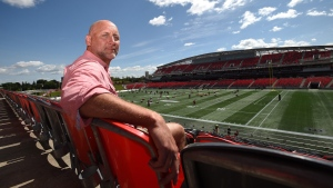 Former CFL player Ken Evraire poses for a photo at TD Place in Ottawa on Wednesday, Aug. 16, 2017. (Sean Kilpatrick / The Canadian Press)