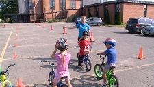 Kids learning bike safety in Pedalheads course.