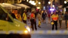 Emergency workers stand on a blocked street in Barcelona, Spain, Thursday, Aug. 17, 2017. (AP / Manu Fernandez)