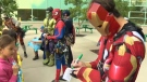Ironman signs an autograph for a young fan at the Alberta Children's Hospital