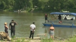 Police search for missing swimmer in Red River