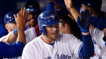 Toronto Blue Jays first baseman Justin Smoak (14) is congratulated by teammates after hitting a two-run home run against the Tampa Bay Rays during eighth inning AL baseball action in Toronto on Thursday, August 17, 2017. (Nathan Denette / THE CANADIAN PRESS)