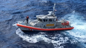 In this photo released by the U.S. Coast Guard, a Response Boat-Medium boat crew from Coast Guard Station Honolulu conducts a search for five crew members aboard a downed Army UH-60 Black Hawk helicopter approximately two miles west of Kaena Point, Oahu, Hawaii, Wednesday, Aug. 16, 2017. (Petty Officer 2nd Class Tara Molle / U.S. Coast Guard photo via AP)