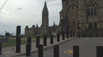 Bollards, a type of security barrier, are seen outside Parliament Hill in Ottawa.
