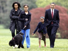 Malia Obama walks with new dog Bo, followed by U.S. President Barack Obama, Sasha Obama and first lady Michelle Obama on the South Lawn at the White House in Washington, on Tuesday, April 14, 2009. (AP / Charles Dharapak)
