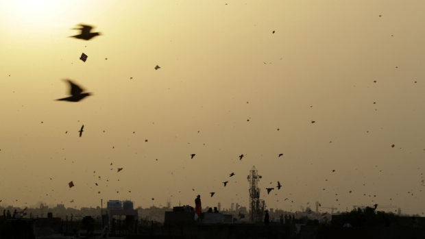 Birds fly among kites on Independence Day in the old quarters of New Delhi, India on Tuesday, Aug. 15, 2017. (AP / Tsering Topgyal)