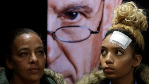 Gabriella Engels, right, and her mother, Debbie Engels look on during a media conference in Pretoria, South Africa, Thursday, Aug. 17, 2017. (AP Photo/Themba Hadebe)