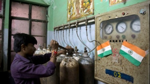 In this Aug. 12, 2017 file photo, a hospital staff member checks newly arrived oxygen cylinders at Baba Raghav Das Medical College Hospital in Gorakhpur, in the northern Indian state of Uttar Pradesh. (AP Photo/Rajesh Kumar Singh, File)