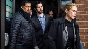 Marco Muzzo (centre) leaves the Newmarket courthouse surrounded by family members including his mother Dawn Muzzo (right) on Thursday, Feb. 4, 2016. (Christopher Katsarov / THE CANADIAN PRESS)