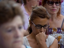 People observe a minute of silence in memory of the terror attack victims in Cambrils, Spain, Friday, Aug. 18, 2017. (AP Photo/Emilio Morenatti)