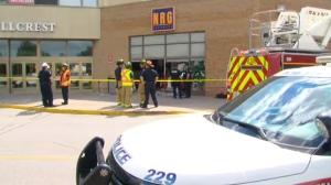 Emergency crews at the scene of a crash where a truck slammed into a hair salon inside Hillcrest Mall on August 18, 2017.