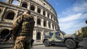 Italian soldiers patrol the Colosseum area in Rome, a day after a deadly van attack in Barcelona, Spain, on Aug. 18, 2017. (Angelo Carconi/ANSA via AP)
