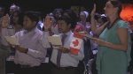Taking the oath to officially become Canadians