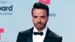 In this April 27, 2017 file photo, singer Luis Fonsi arrives at the Latin Billboard Awards in Coral Gables, Fla. (AP Photo/Wilfredo Lee, File)
