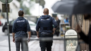 Armed police officers secure the area after several people were stabbed on the Market Square in Turku, Finland, on Aug. 18, 2017. (Roni Lehti/Lehtikuva via AP)