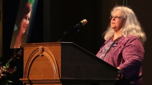 Susan Bro, mother to Heather Heyer, speaks during a memorial for her daughter, Wednesday, Aug. 16, 2017, at the Paramount Theater in Charlottesville, Va. (Andrew Shurtleff / The Daily Progress via AP)