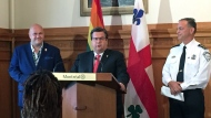 Pride Montreal president Eric Pineault and Montreal police chief Philippe Pichet stand beside Mayor Denis Coderre as he officially apologizes to Montreal's LGBTQ community for decades of attacks and harassment on Aug. 18, 2017 (CTV Montreal/Derek Conlon)