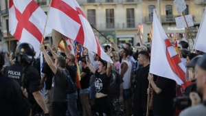 Far-right protesters shout slogans after a van attack in Barcelona, Spain, on Aug. 18, 2017. (Emilio Morenatti / AP)