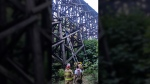 Two girls got stuck climbing the rail trestle over French Creek after they went too high and got scared, according to fire officials. Aug. 17, 2017. (Courtesy Parksville Volunteer Fire Department)