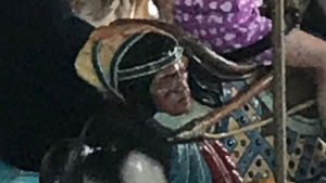 Jessica Hernandez shared this photo of a carousel horse that featured an Indigenous man's severed head in a bag on Twitter. (@jessh4406/Twitter)