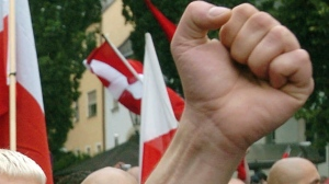 FILE - In this file photo dated Saturday, Aug. 21, 2004, Neo-Nazi sympathizers demonstrate prior to the beginning of a commemoration march for Adolf Hitler's deputy Rudolf Hess in the northeastern Bavarian town of Wunsiedel where Hess is buried. (AP)