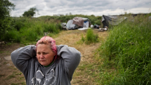 Misty Micheau Bushnell looks over the memorial marking the spot where her boyfriend Shawn Vann Schreck died two days before in a homeless encampment where they live along the river in Aberdeen, Wash., Wednesday June 14, 2017. (AP Photo/David Goldman)