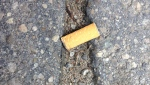 A cigarette butt can be seen in Barrie, Ont. on Friday, Aug. 18, 2017.