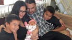 The Lavallee family holds newborn Catherine Corrine Shannon at Saskatoon's Royal University Hospital on Friday, Aug. 18, 2017. The two-week-old infant was diagnosed with a rare and fatal heart condition. (Mark Villani/CTV Saskatoon)