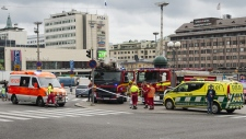 Rescue services attend the scene after a multiple stabbing incident on the Market Square in Turku, Finland, Friday Aug. 18, 2017, after several people were stabbed. A man is thought to have stabbed several people in Finland's western city of Turku before police shot him in a leg and detained him, police said, adding that authorities were looking for more potential suspects. (Roni Lehti/Lehtikuva via AP)