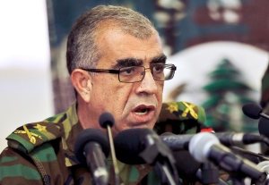 Brig. Gen. Ali Qanso, chief military spokesman, speaks during a press conference at the Lebanese Defense Ministry in Yarzeh near Beirut, Lebanon, Saturday, Aug. 19, 2017. (Bilal Hussein/AP Photo)