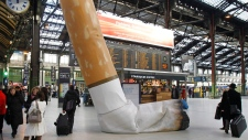 This Tuesday Dec. 4, 2012 file photo shows a symbolic cigarette butt setting up inside Gare de Lyon railway station in Paris, France as part of a publicity campaign against rudeness by Paris's public transport authority. (AP Photo/Remy de la Mauviniere, File)