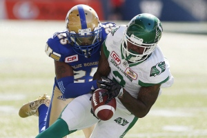 Winnipeg Blue Bombers' Bruce Johnson (25) strips the ball from the hands of Saskatchewan Roughriders' Ricky Collins Jr. (3) during first half CFL Banjo Bowl action, in Winnipeg on September 10, 2016. Wide receiver Ricky Collins Jr. was acquired by the Hamilton Tiger-Cats on Friday night in a trade with the Saskatchewan Roughriders. (John Woods / THE CANADIAN PRESS)