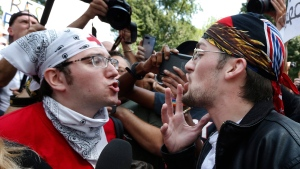 """A counterprotester, left, confronts a professed supporter of President Donald Trump at a """"Free Speech"""" rally by conservative activists on Boston Common, Saturday, Aug. 19, 2017, in Boston. (AP Photo/Michael Dwyer)"""