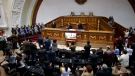 Members of the diplomatic corp, left , listen as lawmakers applaud during a session of Venezuela's National Assembly in Caracas, Venezuela, Saturday, Aug. 19, 2017. (Ariana Cubillos/AP Photo)