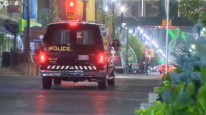 A CPS unit stopped near the Jack Singer Concert Hall during Friday night's investigation into a stabbing