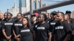 Retired New York City Police Officer Frank Serpico, centre, stands with other members of law enforcement during a rally to show support for Colin Kaepernick, in New York, on Saturday, Aug. 19, 2017. (AP Photo/Mary Altaffer)