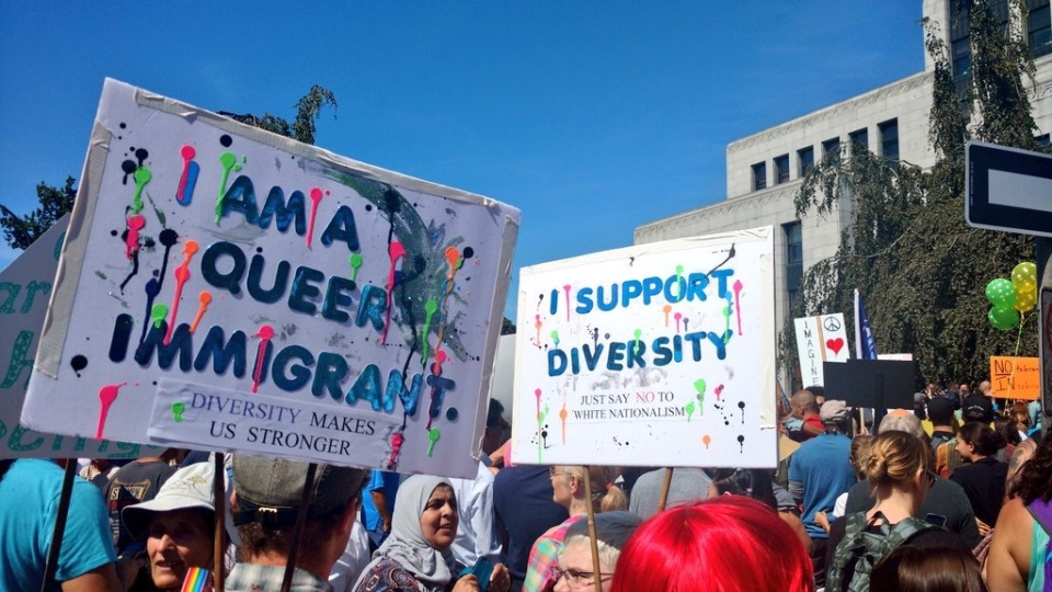 Anti-racism demonstrators displayed colourful messages promoting immigration and diversity. (CTV)
