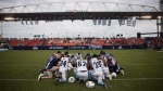 Toronto Argonauts and Montreal Alouettes players huddle on the field for prayer following CFL football action in Toronto on Saturday August 19, 2017. THE CANADIAN PRESS/Chris Young