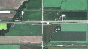 The intersection of the Trans-Canada Highway and Highway 16, just west of Portage la Prairie, Man. is seen in this Google Maps image. A man and two children are dead after the minivan they were in collided with a semi while attempting to turn onto Highway 16, RCMP said. (Source: Google Maps)
