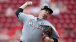Miami Marlins starting pitcher throws against the Cincinnati Reds during the first inning of a baseball game, Sunday, July 23, 2017, in Cincinnati. (AP Photo / Gary Landers)