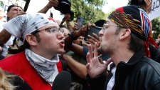 "A counterprotester, left, confronts a supporter of President Donald Trump at a ""Free Speech"" rally by conservative activists on Boston Common, Saturday, Aug. 19, 2017, in Boston. Thousands of counterprotesters marched through downtown Boston on Saturday, chanting anti-Nazi slogans and waving signs condemning white nationalism ahead of a rally being staged by conservative activists a week after a Virginia demonstration turned deadly. (AP Photo/Michael Dwyer)"