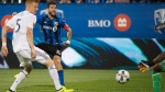 Montreal Impact's Ignacio Piatti (10) scores against Real Salt Lake's goalkeeper Nick Rimando as Justen Glad (15) defends during first half MLS soccer action in Montreal, Saturday, August 19, 2017. THE CANADIAN PRESS/Graham Hughes